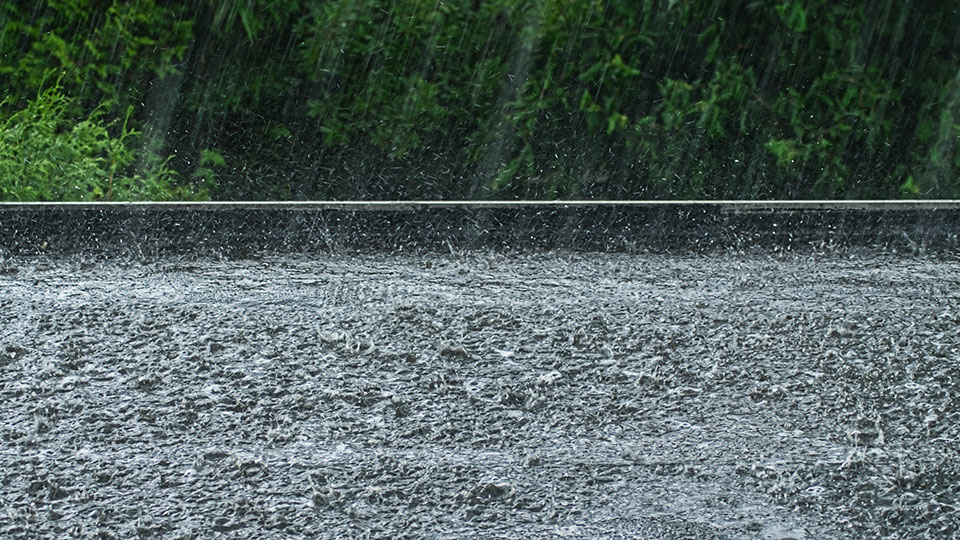 Heavy rain falling on the ground.