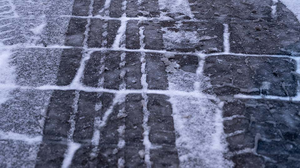 The ground covered in ice.