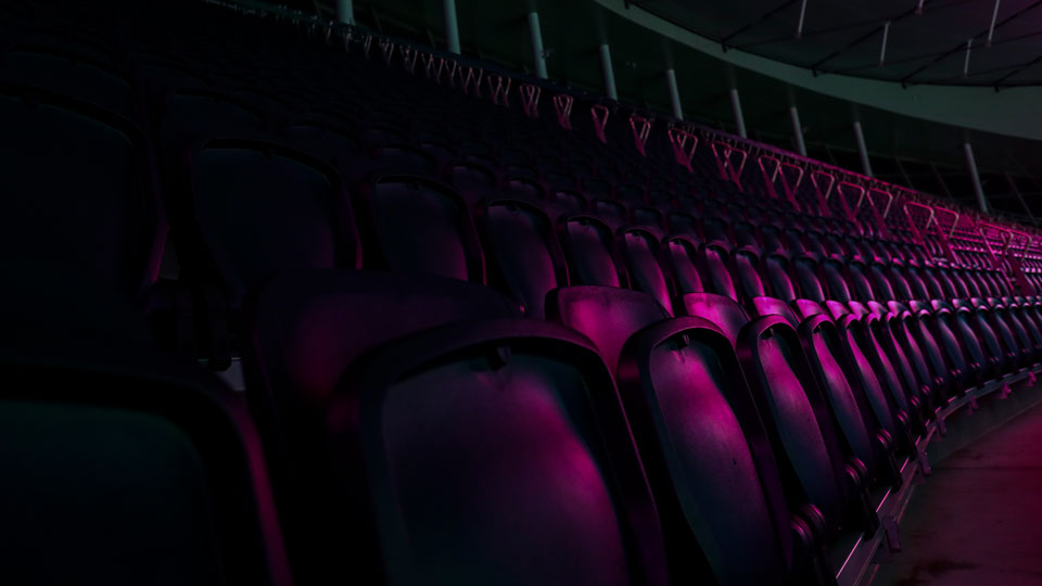 UV light illuminates the empty stands before the English Premier League soccer match