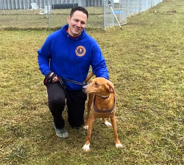 President of Healthy Hearts and Paws Project Jason Cooke poses with Eddie, one of the dogs they are helping