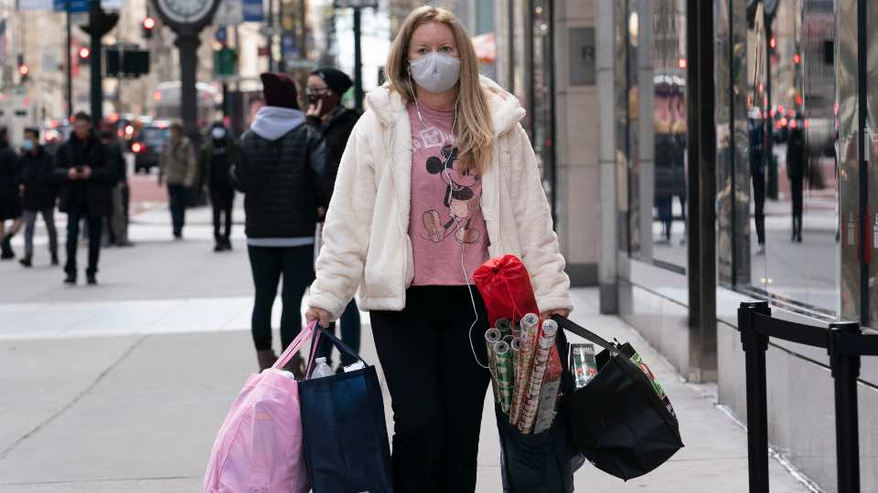 In this Dec. 10, 2020 file photo, a woman carries shopping bags in New York. The nation's largest retail trade group is forecasting strong retail sales growth in 2021 that could surpass last year's pace as individuals get vaccinated and the economy reopens. The National Retail Federation anticipates that retail sales will grow between 6.5% and 8.2% to more than $4.33 trillion this year.