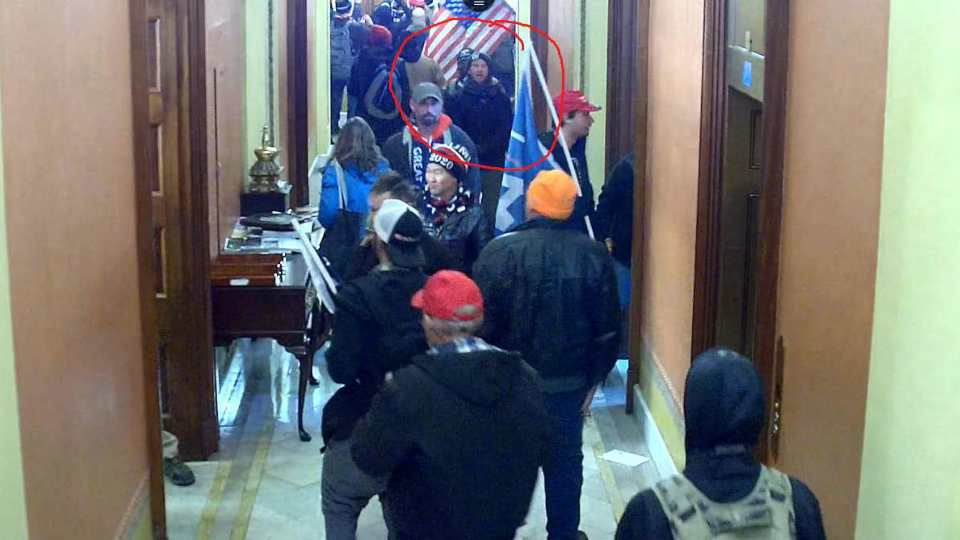 In this image taken from Capitol building security camera footage and released in a criminal complaint by the U.S. District Court for the District of Columbia, Derek Jancart, circled in red by the source, joins other rioters who stormed the U.S. Capitol on Jan. 6, 2021, in Washington. Jancart, of Ohio, was arrested Tuesday, Feb. 23, and accused of entering the U.S. Capitol after family members and a former coworker identified him in footage captured during the deadly insurrection, according to U.S. District Court documents.