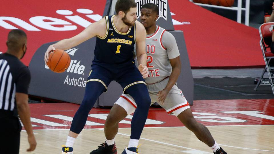 Michigan's Hunter Dickinson, left, posts up against Ohio State's E.J. Liddell during the first half of an NCAA college basketball game Sunday, Feb. 21, 2021, in Columbus, Ohio.