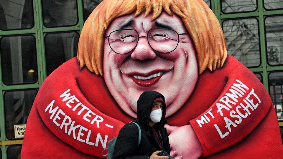 A political carnival float depicting German chancellor Angela Merkel