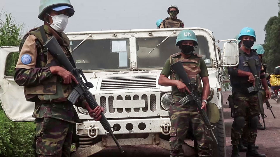 United Nations peacekeepers guard the area where a U.N. convoy was attacked