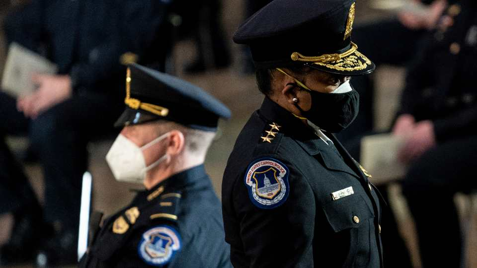 Capitol Police Acting Chief Yogananda Pittman departs a ceremony memorializing U.S. Capitol Police officer Brian Sicknick, as an urn with his cremated remains lies in honor on a black-draped table at the center of the Capitol Rotunda, Wednesday, Feb. 3, 2021, in Washington.