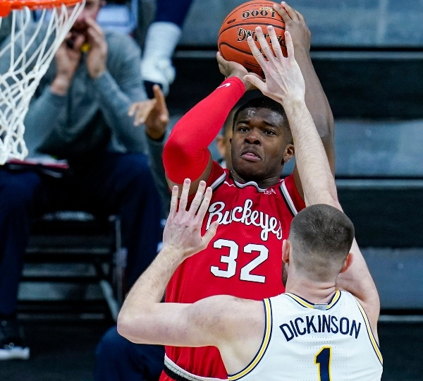Ohio State forward E.J. Liddell (32) shoots over Michigan center Hunter Dickinson (1) in the first half of an NCAA college basketball game at the Big Ten Conference tournament in Indianapolis, Saturday, March 13, 2021.