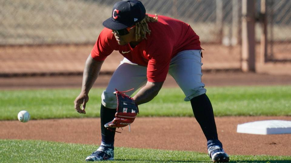 Cleveland Indians third baseman Jose Ramirez fields a ground ball during a spring training baseball practice Monday, Feb. 22, 2021, in Goodyear, Ariz.