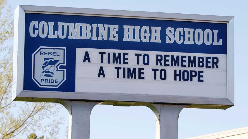 FILE - In this April 19, 2004, file photo, a sign at Columbine High School in Littleton, Colo. Students who were planning to attack schools showed the same types of troubled histories as those who carried them out - they were badly bullied, often suffered from depression with stress at home, and their behavior worried others, according to a U.S. Secret Service study released March 30, 2021