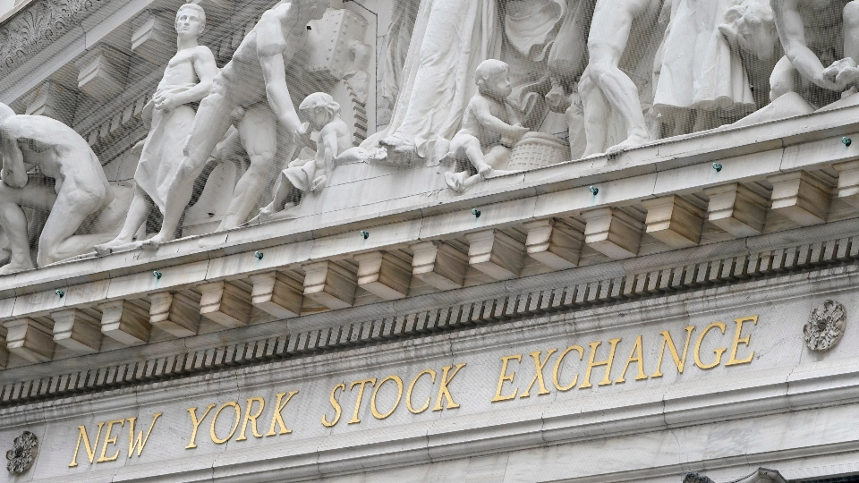 In this Nov. 23, 2020 file photo, stone sculptures adorn the New York Stock Exchange.