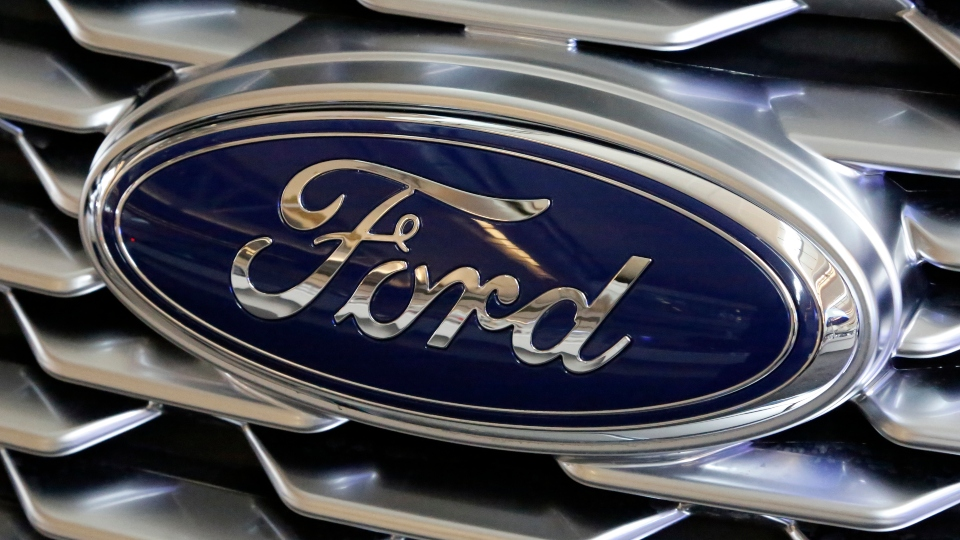 This Feb. 15, 2018, file photo shows a Ford logo on the grill of a 2018 Ford Explorer on display at the Pittsburgh Auto Show.