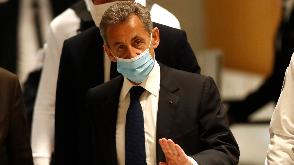 Former French President Nicolas Sarkozy arrives at the courtroom Monday, March 1, 2021 in Paris.