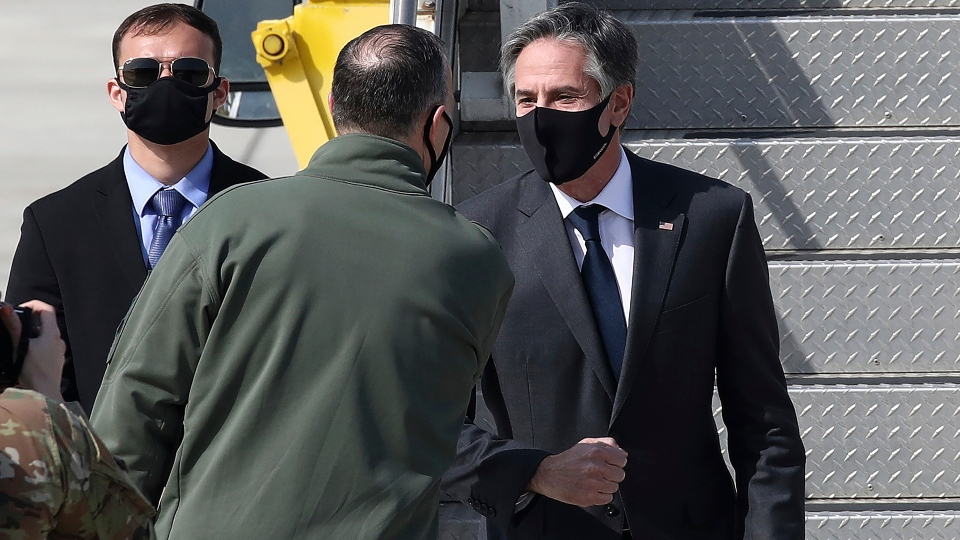U.S. Secretary of State Antony Blinken, right, talks with Scott Pleus, Deputy Commander of the United States Forces Korea on his arrival at Osan Air Base Wednesday, March 17, 2021, in Pyeongtaek, South Korea.
