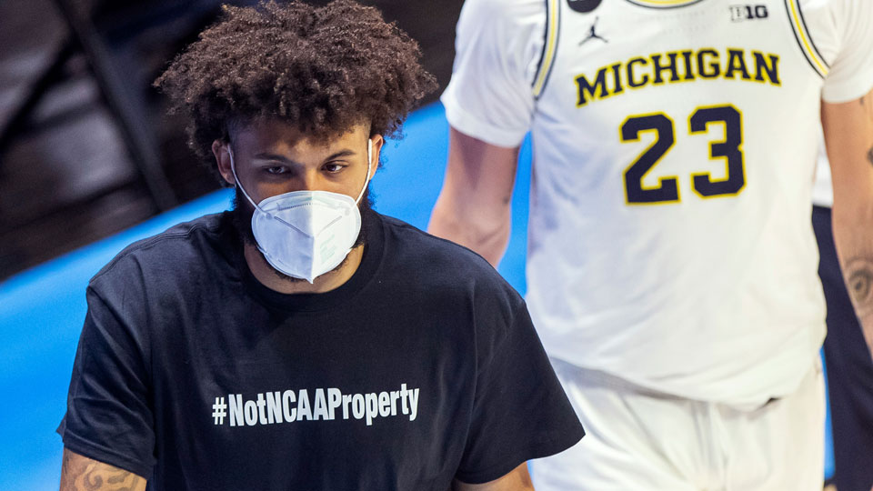 """Michigan's Isaiah Livers wears a T-shirt that reads """"#NotNCAAProperty"""""""