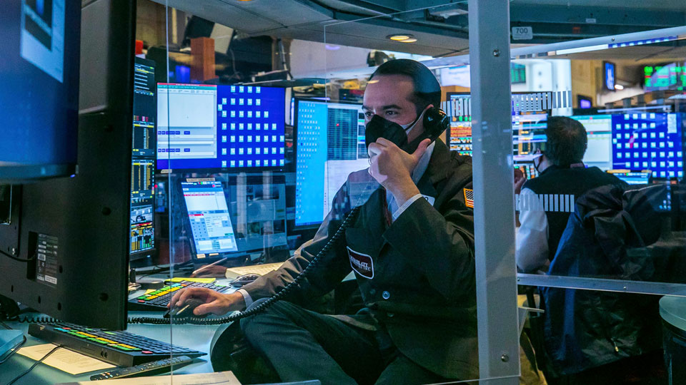 New York Stock Exchange, traders work on the floor, Monday, March 1, 2021