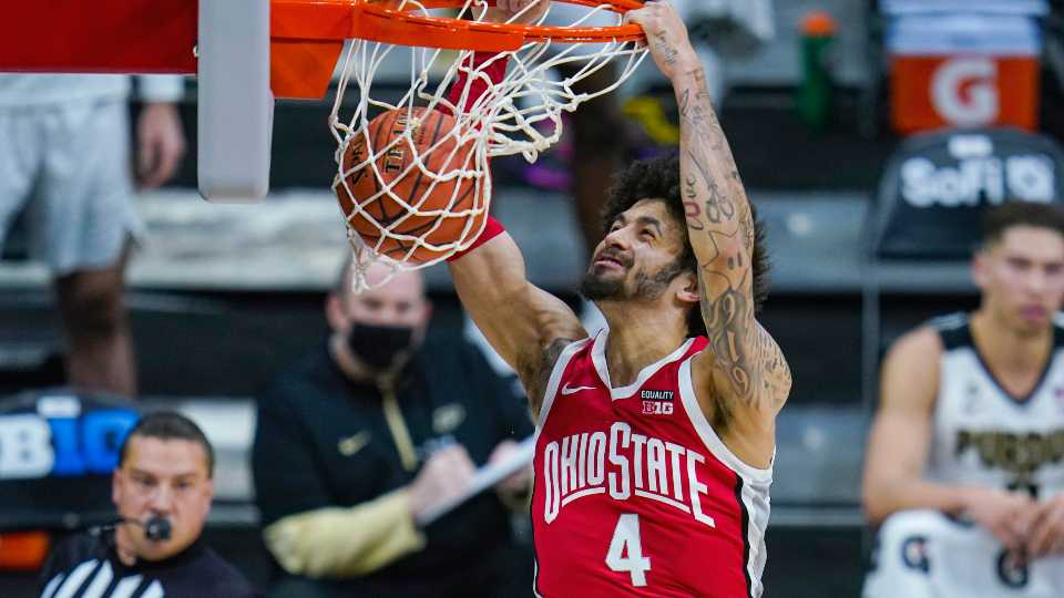 Ohio State guard Duane Washington Jr. (4) gets a basket on a dunk against Purdue in the first half of an NCAA college basketball game at the Big Ten Conference tournament in Indianapolis, Friday, March 12, 2021.
