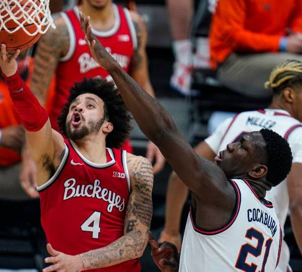 Ohio State guard Duane Washington Jr. (4) shoots over Illinois center Kofi Cockburn (21) in an NCAA college basketball championship game at the Big Ten Conference tournament in Indianapolis, Sunday, March 14, 2021.