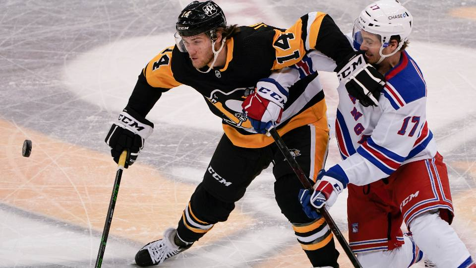 Pittsburgh Penguins' Mark Jankowski (14) and New York Rangers' Kevin Rooney (17) battle for the puck during the third period of an NHL hockey game, Sunday, March 7, 2021, in Pittsburgh.
