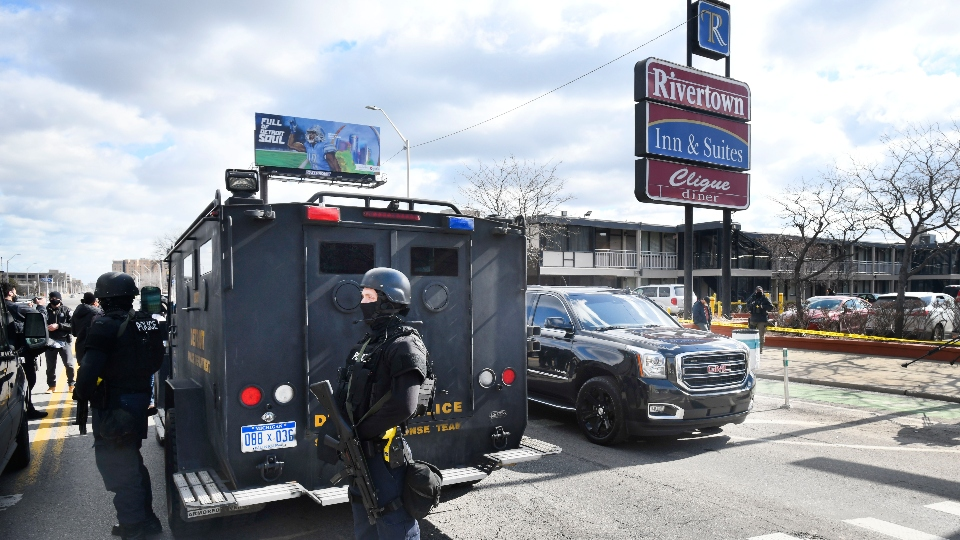 Detroit police monitor the scene of a shooting at the Rivertown Inn and Suites on East Jefferson Avenue in Detroit, Mich., on Monday, March 1, 2021.
