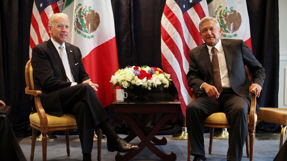 President Joe Biden, left, poses for photos with Mexican President Andres Manuel Lopez Obrador