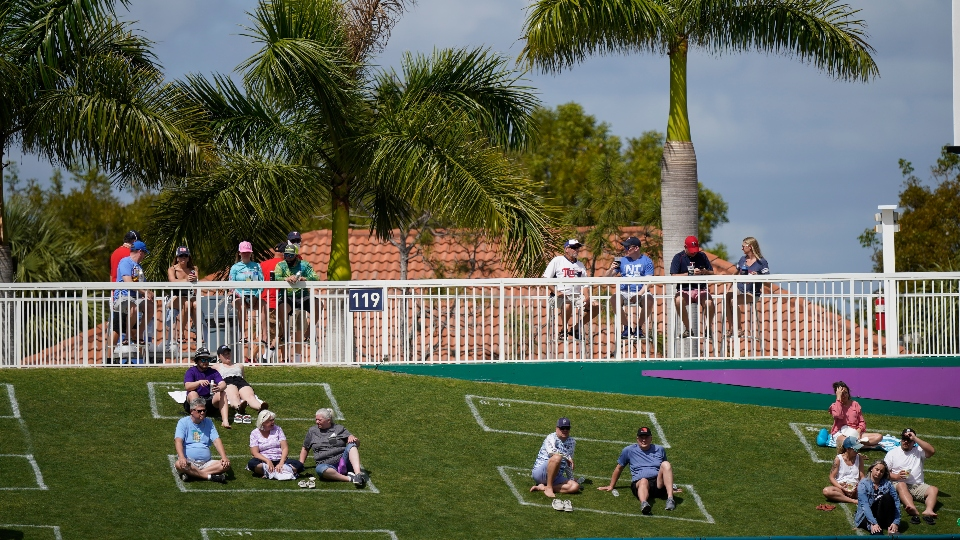 Fans sit in social distance squares during a spring training baseball game with the Minnesota Twins and Boston Red Sox on Sunday, Feb. 28, 2021, in Fort Myers, Fla.