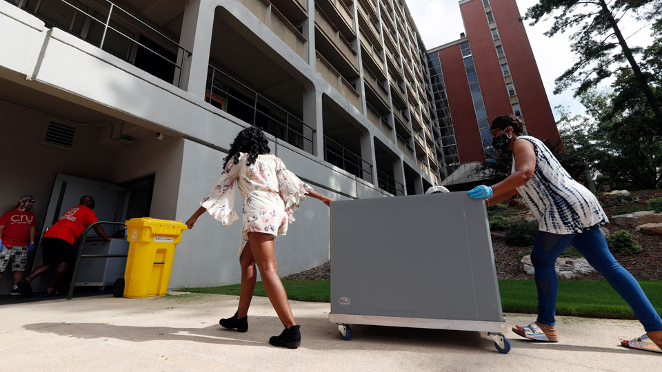 College students begin moving in for the fall semester