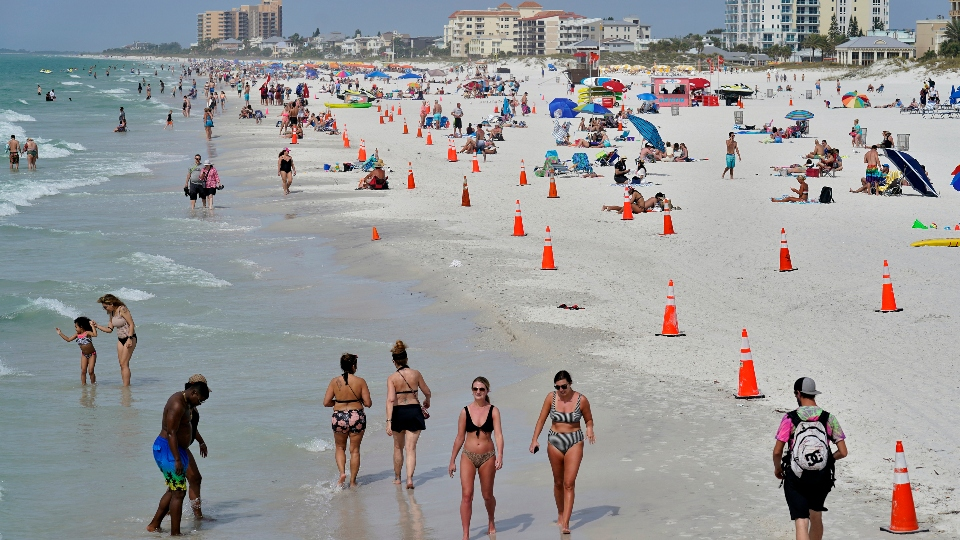 Beachgoers take advantage of the weather as they spend time on Clearwater Beach Tuesday, March 2, 2021, in Clearwater, Fla., a popular spring break destination, west of Tampa.