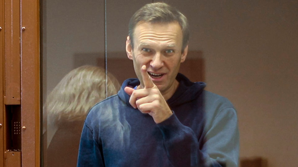 Russian opposition leader Alexei Navalny gestures during a court hearing