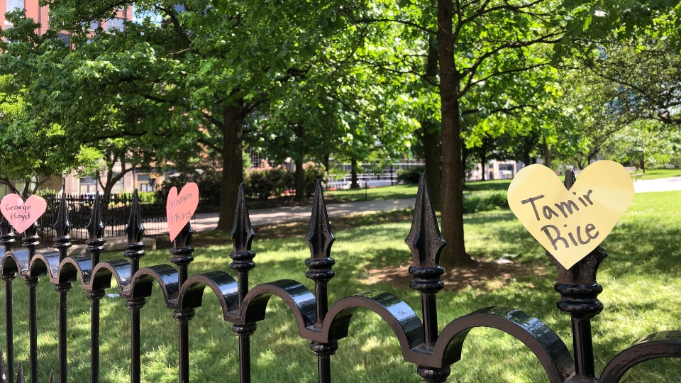 Hearts with the names of black people who died at the hands of police are displayed on a fence as part of a protest at the Ohio Statehouse in Columbus, Ohio, on Saturday, June 6, 2020.
