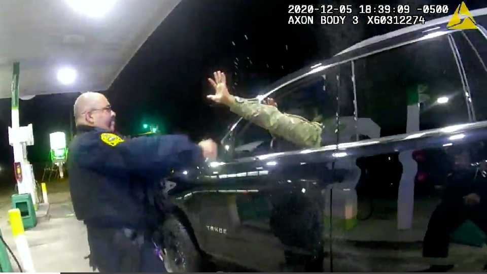 In this image made from Windsor, (Va.) Police video, A police officer uses a spray agent on Caron Nazario on Dec. 20, 2020, in Windsor, Va. Nazario, a second lieutenant in the U.S. Army, is suing two Virginia police officers over a traffic stop during which he says the officers drew their guns and pointed them at him as he was dressed in uniform. Caron Nazario says his constitutional rights were violated by the traffic stop in the town of Windsor in December.