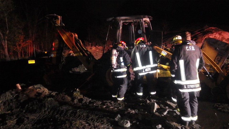 Police and fire helped extinguish a backhoe that was on fire in Columbiana this morning. (5)