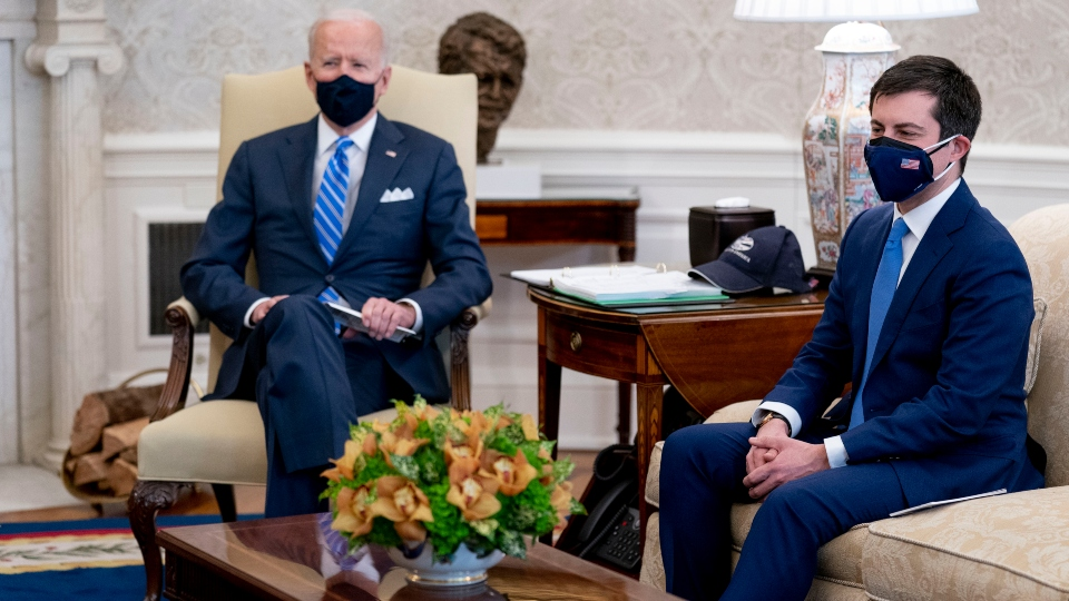 In this March 4, 2021, file photo, President Joe Biden and Transportation Secretary Pete Buttigieg, right, meet with Vice President Kamala Harris and members of the House of Representatives in the Oval Office of the White House in Washington, on infrastructure.