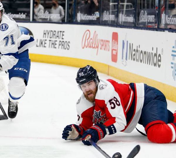 Columbus Blue Jackets defenseman David Savard, right, reaches for the puck in front of Tampa Bay Lightning forward Anthony Cirelli during an NHL hockey game in Columbus, Ohio, Tuesday, April 6, 2021. The Blue Jackets won 4-2.