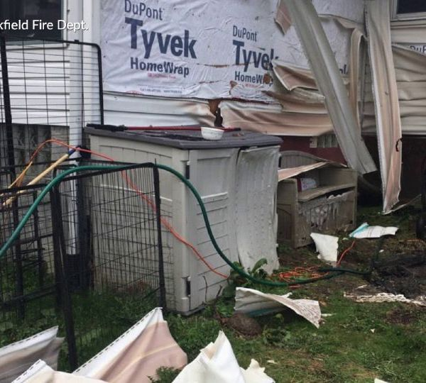 A neighbor jumped into action in Trumbull County Monday to help prevent a fire from further damaging a home in Brookfield.