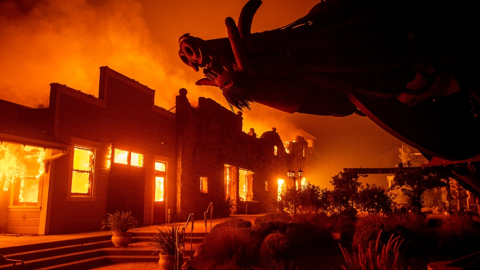 In this Oct. 27, 2019, file photo, flames from the Kincade Fire consume Soda Rock Winery in Healdsburg, Calif.