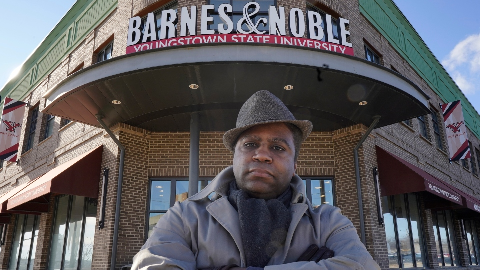 Andre Brady poses for a photo outside the Barnes & Noble, Thursday, Jan. 21, 2021, in Youngstown, Ohio.