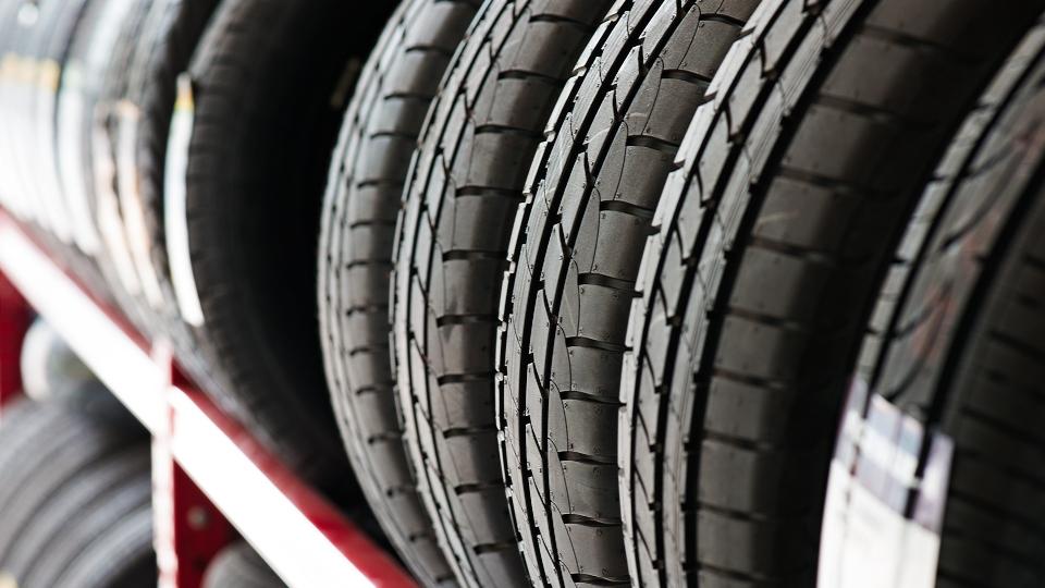 Shelf of car tires, generic.