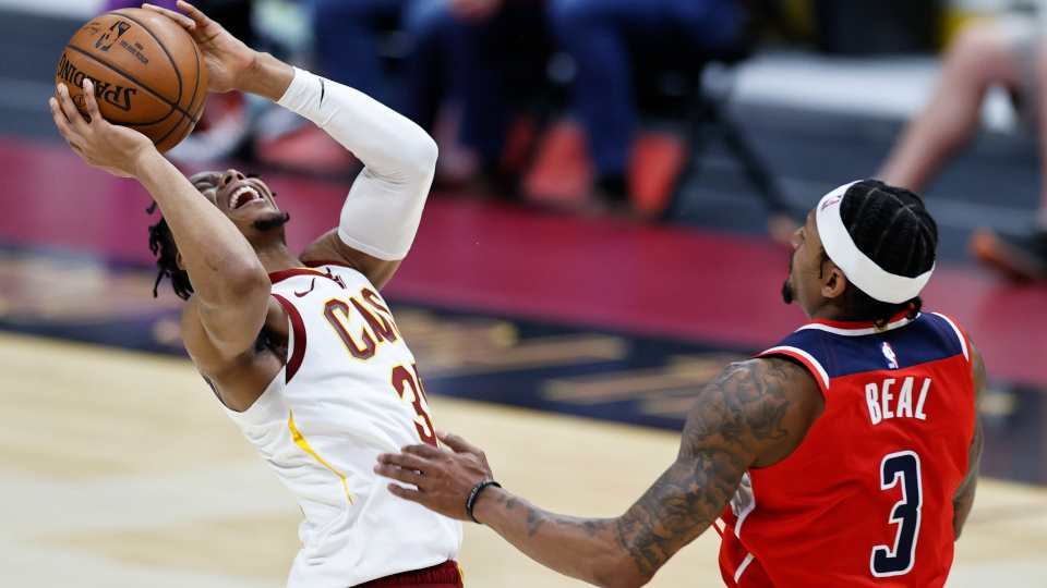 Cleveland Cavaliers' Isaac Okoro (35) shoots against Washington Wizards' Bradley Beal (3) during the first half of an NBA basketball game, Friday, April 30, 2021, in Cleveland.