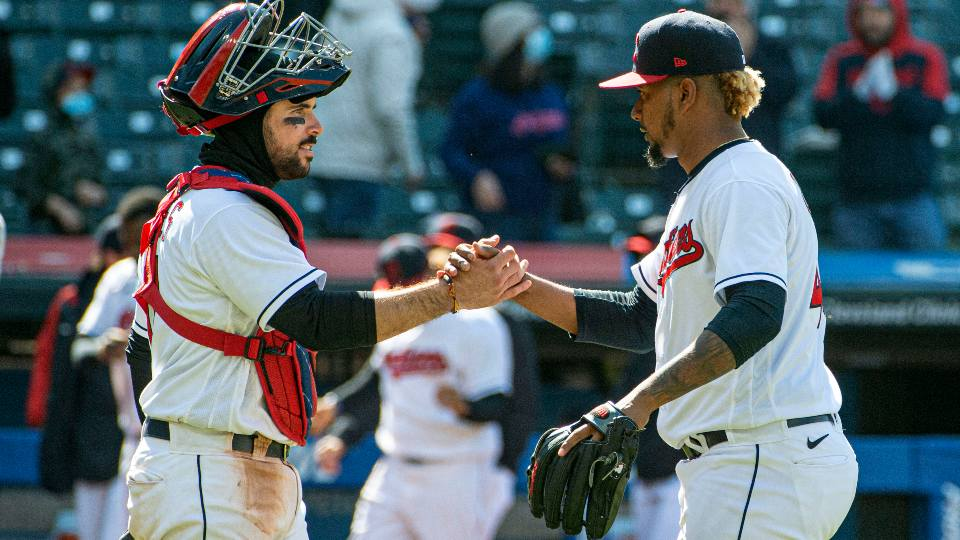 Cleveland Indians' catcher Austin Hedges congratulates closer Emmanuel Clase after the final out against the New York Yankees at a baseball game in Cleveland, Sunday, April 25, 2021.