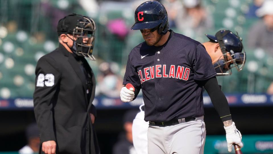 Cleveland Indians' Roberto Perez, front right, heads to the dugout after striking out during the ninth inning of a baseball game against the Detroit Tigers, Saturday, April 3, 2021, in Detroit.