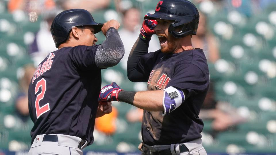 Cleveland Indians' Jordan Luplow, right, is greeted by Yu Chang after they both scored on Luplow's two-run home run during the seventh inning of a baseball game against the Detroit Tigers, Sunday, April 4, 2021, in Detroit.