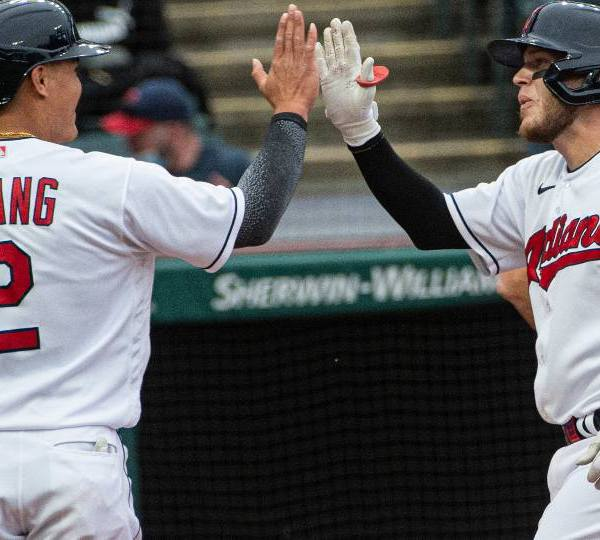 Cleveland Indians' Roberto Perez, left, is greeted by Yu Chang after hitting a two-run home run off Tarik Skubal during the second inning of a baseball game in Cleveland, Saturday, April 10, 2021.