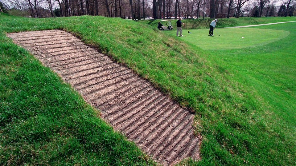 This April 6, 2000 file photo shows a concrete walkway, foreground, that allows golfers access to the top of an ancient American Indian mound at Moundbuilders Country Club in Newark, Ohio.