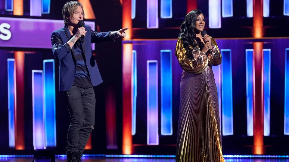 Hosts Keith Urban, left, and Mickey Guyton speak at the 56th annual Academy of Country Music Awards on Sunday, April 18, 2021, at the Grand Ole Opry in Nashville, Tenn.
