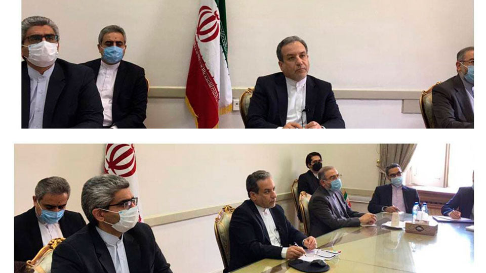 This combined photo released by the Iranian Foreign Ministry, shows Iranian diplomats attending a virtual talk on nuclear deal with representatives of world powers, in Tehran, Iran, Friday, April 2, 2021