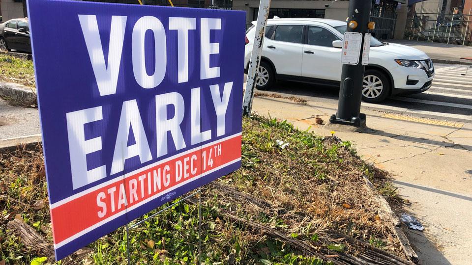 Sign in an Atlanta neighborhood urges people to vote early in Georgia's two U.S. Senate races