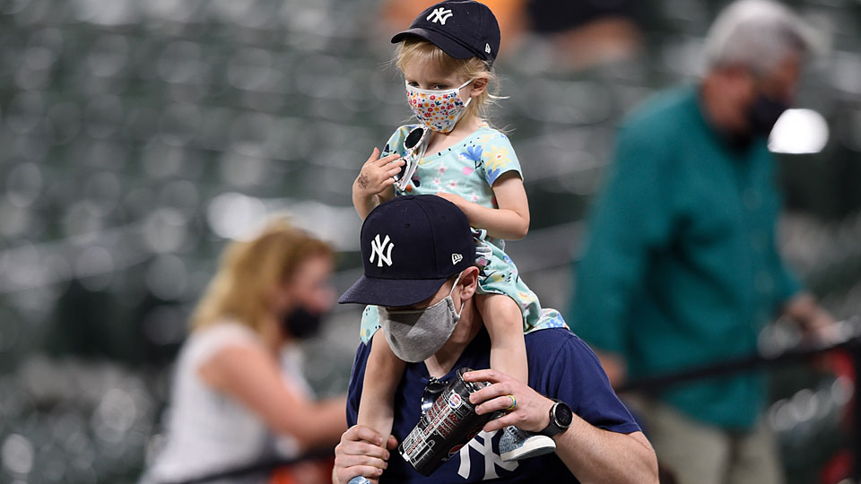 A couple of Yankee fans walk through the stands during the Baltimore Orioles and New York Yankees baseball game, Wednesday, April 28, 2021