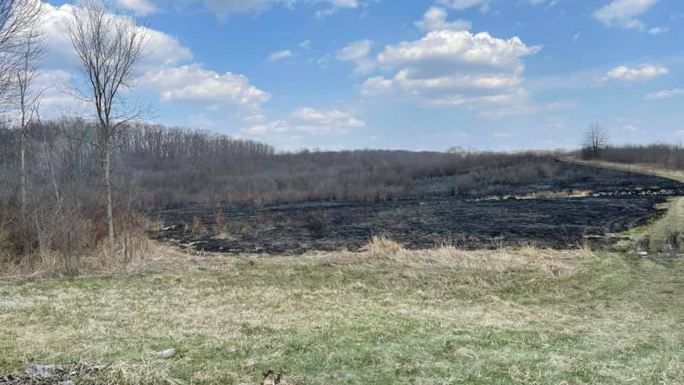 Crews worked to control a brush fire Tuesday in Farmington Township on land owned by the Ohio Department of Natural Resources.