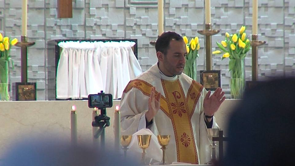 Father Christopher Cicero was installed into two parishes in Warren, one of which he grew up in.