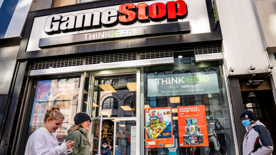 In this Jan. 28, 2021, file photo, pedestrians pass a GameStop store on 14th Street at Union Square, in the Manhattan borough of New York.